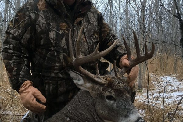 Mark and his first Saskatchewan Muzzle loader Whitetail Buck
