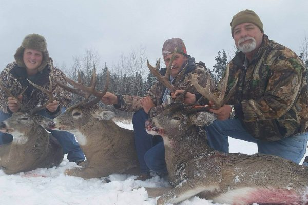 Tree Happy Hunters with there Saskatchewan Whitetail Bucks